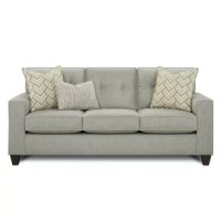 The Michigantown Pewter Sofa is a beautiful transitional styled frame accented with contrasting accent pillows and a contrasting kidney pillow. With track arms, loose reversible box border seat cushions and button tufted inside back cushions. With them being reversible, you can rotate them to prolong the life of the fabric, as well as, the cushion cores. The coffee finish tapered wood legs only accent this popular frame. The material is not only beautiful but also durable.