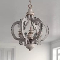 As much a work of art as a lighting fixture, this French country chic chandelier elevates the look of any room in your home, from the dining room to the entryway. This eye-catching lantern design is crafted from metal and wood, and features ornate C-shaped accents that fan out around the center bulbs. It's finished in a neutral, whitewashed hue for an antique-inspired look, and accommodates six bulbs of up to 60W (not included) each around its candelabra base.  Hand-curated by Kelly Clarkson.