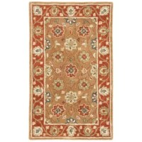 Unadorned floor bumming you out? Spruce up any ensemble with an area rug, a great way to soften the step of hardwood and tile while adding undeniable style. This rug sports a Persian-inspired motif, offering hues of rust, brown, and deep red. Hand-tufted, it's made from 100% wool with a low 0.63'' pile height, making this piece an excellent addition to busy areas in your abode. Though it comes with a cotton backing, we recommend a rug pad for additional stability.