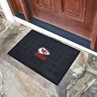 Make a great first impression when guests come over with officially licensed Door Mats by Sports Licensing Solutions. Adorned with your favorite team's logo, these door mats make a statement while keeping dirt and mud from entering your home. Heavy-duty vinyl construction ensures a durable mat. Deep reservoirs capture and contain water and debris. Rugged ribs scrape shoes clean so dirt and debris isn't tracked into your home. Your favorite team's logo is molded in 3D construction. Made in the...