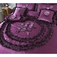 Fall in love with the night with this Comforter Set. This enchanting set is sure to set you on a whirlwind romance as you curl further into the covers. With dark purple covers and beautiful ribbon flowers, you are sure to wake up well-rested in the morning. Satin Ruffles give the appearance of cascading water down your bed.