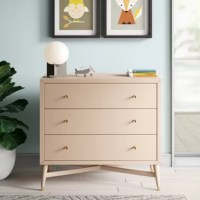 This 3-drawer dresser brings chic, mid-century style to your little one's nursery (or a guest bedroom!). It showcases a crisp and clean-lined body, along with four tapered, splayed legs down below with an X-shaped cross bar for support. Each leg is capped off with a metal tip that matches this dresser's hourglass drawer pulls for a cohesive look. It's made from solid and engineered wood, and features a neutral finish perfect for creating a crisp and clean nursery.