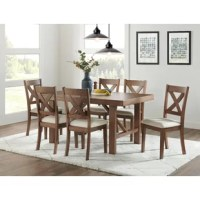 This Branham 7 Piece Dining Set features a solid wood edge band profile that makes a sophisticated statement. A unique honey finish and elegant trestle base provide stylish elements to this piece.