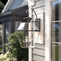 Your outdoor lights are heavy lifters when it comes to rounding out your home: not only do they set the tone for your decor, but they also keep your outdoor spaces safe by brightening up the night. Take this one, for example: perfect for a traditional look on your patio, garage, or entryway, this piece is crafted from a metal frame with beveled glass panels in an empire lantern style. A shepherd's crook finial adds an extra touch of classic style to this piece. Inside, this luminary features...