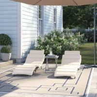 Whether you're looking to sprawl poolside or soak up the sun from a patio, patio lounge chairs like this are just the thing to help you enjoy the outdoors in style. Crafted from acacia woods, this set of two chairs features a sinuous design sure to help you relax, while the included cushions add a little extra padding while you relax. Plus, thanks to the included end table, you can kick back and keep your latest summer reads or a cool drink in easy reach.