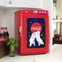 Koolatron Coca Cola Fridge Red thermoelectric cooling system is quiet, lightweight, compact and portable. This Portable Fridge can holds up to 28 - 12 oz. cans. Coca Cola Fridge Kwc 25 has a self-locking recessed door handles and removable shelves.