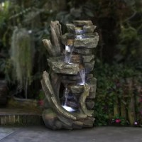 Relax and enjoy the sounds of nature with LED lights! You will feel like you are sitting next to a majestic forest river stream in the great outdoors all while relaxing in your own backyard. It has a 10L capacity and features an internal pump that keeps the water flowing - just plug it in! This outdoor fountain looks great in your garden, patio, deck, porch, or yard space. Take in the tranquil sounds of the water gently cascading over natural-looking stone. The polyresin, stone powder, plastic...