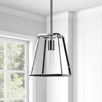 Bring an industrial, modern feel to your living space with this geometric, open-framed pendant. Featuring a clean-cut, rhombus-shaped frame allowing an exposed view to the bulb (not included).
