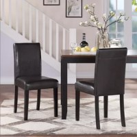 Whether pulled up to a breakfast bar for Sunday brunch or the dining room table for the nightly family meal, a good dining chair helps set the atmosphere. Take this parsons chair, for example: Founded atop four poplar legs and a rubberwood frame, it demonstrates clean lines that blend well with any aesthetic. Faux leather upholstery rounds out the look. Plus, felt foot pads protect hardwood flooring from scratches and scrapes.