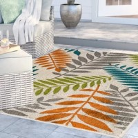 Whether you're located by the beach or are a little more landlocked, you can bring a bit of island-inspired style to your backyard with this eye-catching area rug.
