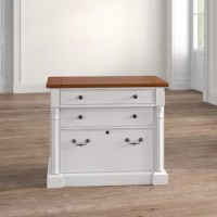With a rustic cottage inspiration, this 2-Drawer Lateral Filing Cabinet brings a casual look to any office setting. The lateral file features a locking file drawer that accommodates legal and letter documents.
