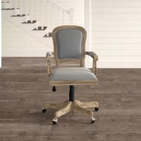 Mix a dash of classic character into your office ensemble with this traditional desk chair. Crafted from wood, this piece sports a rustic brown and driftwood finish for a warm touch. Beige, blue and gray fabric upholstery (made from 100% polyester) covers the seat and back, pairing with a vintage-inspired design for a french country—inspired look. Caster wheels down below offer must-have mobility. Thanks to this design's adjustable seat height, you can personalize it to suit your...