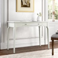 Writing desk? Console table? TV stand? You decide – this traditional desk measures 42'' W and is the perfect pick for almost any room in your home. A slightly curved apron and legs give this solid wood design a touch of sophistication, while its clean-lined design makes it a perfect fit for any ensemble. Use it to anchor the den or dining room in classic style, then use its drawer to stow everything from stationary to scissors. Plus, it's available in a range of solid hues that are sure to...