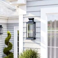 One if by land, two if by sea…and one that mounts to your wall if you want to illuminate your space in style! This lantern light is the perfect pick for adding some understated appeal to your decor. Crafted from metal, this piece puts a contemporary twist on a traditional design, featuring a sleek, streamlined silhouette in a black finish. Three glass panels diffuse light from two candelabra-base bulbs, while its ability to withstand wet locations makes it the perfect pick for your outdoor...