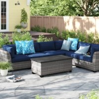Bring your patio or deck to life with this 7-piece outdoor sectional set. Its three corner pieces and three armless pieces showcase gently angled backs and wide arms, which add an inviting look when paired with its included acrylic cushions. All-weather rattan wraps around its rust-resistant, powder-coated aluminum frame, giving this set the oomph it needs to sit outdoors during inclement weather. Best of all, its included coffee table lifts up for added storage.