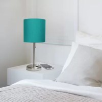 This product features a brushed steel base and a fabric shade. It comes equipped with a USB seated in the base for use to charge mobile phones, handheld games, tablets, and other small electronics. This item will add fabulous flair to any room. Perfect for bedrooms, kids and teens, college dorms, nurseries, or fun offices.
