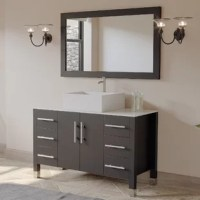 If you need a 48'' bathroom vanity, take a look at this vanity set. This solid wood vanity comes as a complete set that includes an oak cabinet with espresso finish, a white porcelain counter top with square vessel sink, a matching wood trimmed mirror and all the plumbing fixtures needed to finish the installation. Each of the six drawers and two doors has soft close hinges for quiet closings. Adding value to your home is easy with the 48'' magnolia complete bathroom vanity set.