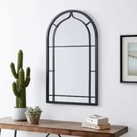 Nothing ties a room together better than a great mirror, and the one you choose to place in your home should reflect your personality and style. Crafted of metal, this elegant mirror features a perfectly aged finish and arched ironwork detailing. Its impressive size and farmhouse-inspired design will create a stunning classic focal point on any wall. Finding the right mirror to suit your style has never been easier.