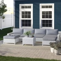 Give you and your family a spot to enjoy warmer weather with this 7-piece patio set! This set includes a modular sectional sofa with two ottomans and a coffee table, and showcases sled legs and streamlined silhouettes for a contemporary feel in your outdoor ensemble. Each piece is crafted with an aluminum frame that's wrapped in resin wicker that makes them both UV- and weather-resistant. And thanks to the included cushions, you can get right to relaxing as soon as this set arrives. Plus, it...