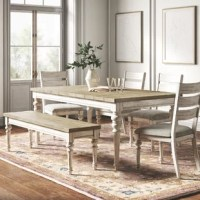 Your dining table is the hub of your home, seating your family for taco night and your friends for a boozy weekend brunch. This table adds a farmhouse-inspired look to your space, thanks to its planked tabletop and turned legs. It's crafted from a blend of solid and engineered wood, with a whitewashed base and light brown top for subtle contrast and a distressed, antique-inspired look. Measuring 72'' W, this dining table comfortably seats six. And don't worry, it comes with four matching...