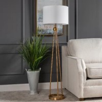 Our metal floor lamp is modern and minimal but provides a statement for your space.Its tripod legs are set on a sleek ring base adorned with a white linen drum shade. Simply sophisticated glam