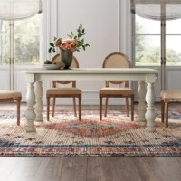 Dining tables are the focal point in every home, giving you a place to gather with your friends and family to enjoy a home-cooked meal (or, let's be real, pizza). This rectangular dining table is crafted from a blend of solid poplar wood and veneers, and showcases a distressed white finish for a rustic touch. Paired with turned legs, this table is perfect for adding French country appeal to your dining room. A removable leaf extends this 66'' W table to 84'' W, so it can comfortably seat up...