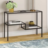 This contemporary console table is the perfect addition for your entryway or living room. The glasses tabletop and two-tiered shelves. Balanced on four legs, the table can hold a weight capacity of 20 LBS.
