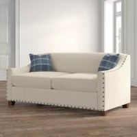 Bring updated appeal to your living area with this nicely tailored Sleeper Sofa Bed. The handsome large-sized nailhead trims coordinates well with the neat, tight back styling of this sofa, two coordinating pillows are included.