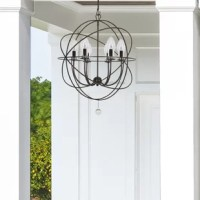 This product renew your outdoor living space with this stunning chandelier now rated for outdoor applications. This fashionable design features a series of flowing sphere shapes surrounding a cluster of candlestick bulbs covered by clear glass shades all suspended by a distinctive chain-and-hook detail. The creative mix combines a contemporary wrought iron form with a traditional, English bronze finish. The clean-lined model looks good in any setting from traditional to contemporary and can be...