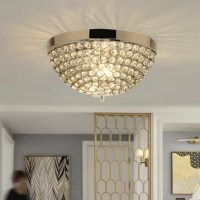 This is the gorgeous crystal ceiling lamp that will provide you with brighter brightness and more secure user experience. The k9 crystals with high refractive index and precise cutting will make the light refract a brilliant view on the ceiling. The base made of stainless steel is durable for your long time use. The lamp caps and wires are safer and made of fire retardant materials, which will reduce the risk of fire effectively. Besides, there are three lamp caps inside the lamp for you to...