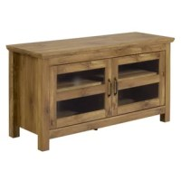 A must-have for living areas and entertainment spaces, this TV stand sets the stage for the big game, a movie marathon, or that season finale everyone's been talking about. This one, for example, features a classically simple design perfect for traditional aesthetics. Crafted from solid and manufactured wood, it features one cabinet, and two interior shelves, allowing you to have room to stow away that digital player, movie collection, and more. It also features media storage, cable...