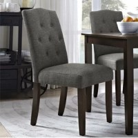 Updating your dining or living area has never been easier than with the Besek Tufted Dining Chair. This chair is very easy to assemble, leaving you stress-free and with a little extra time on your hands. The quality of the chair is noticeable in all of its details. The decorative stitching and the hand-sewn buttons are tasteful, as seen in the traditional diamond pattern button-tufting. The silhouette of the chair, namely the soft camelback design, is classic and elegant. The calming faux linen...