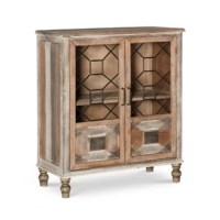 Give your living space a farmhouse look with the inclusion of this cottage-style cabinet. Constructed from solid wood and MDF, it features 1 compartment enclosing a fixed shelf. It is supported by turned legs and showcases a plank style body. The door fronts showcase geometric metal grills and wooden details.