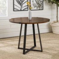 Some of our best memories are created at our dining tables – they host our family dinners, holiday feasts and more. No matter the shape or size, they play an integral role in our home. Take this one for example: Perched atop a crisscross, open frame, this piece works well in a variety of aesthetics from rustic to contemporary. Crafted from manufactured wood, the table sports a circular silhouette, designed to seat up to four after construction.