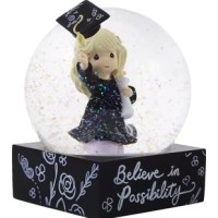 An eye-catching snow globe with a chalkboard look base helps a new graduate welcome a bright future while acknowledging that there is no limit to what they might achieve. Cleverly designed with the cap outside the glass, it gives the appearance that it has just been tossed in the air – a true celebration of all that has been accomplished! Give this unique gift to any recent grad, whether they've just completed grade school, high school, college, or graduate school. It makes a thoughtful...
