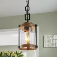 This rich 1-light mini pendant has a chic industrial look with a simple metal housing in wood grain finish. The clear glass shade evokes the comforting style of a traditional canning jar and gives a distinctive touch to this versatile design. A round canopy completes this wonderful addition to your home.