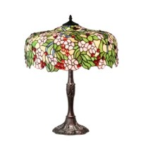 Cardinal red jewel cherries glisten between rosy pink flowers and verdant green leaves in this version of the Diane studio's cherry blossom. Blooms and fruit cascade from the edge of this colorful and intricately patterned stained glass shade. The lovely shade rests on a mahogany bronze finished table lamp base.