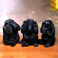 Representing the maxim see no evil, hear no evil, speak no evil, three wise and helpful monkeys make a charming addition to your home decor. Balinese artisan Wayan Nuliati creates this sculpture trio, hand-carving each monkey from suar wood with a black polished finish.