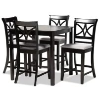 Elevate your dining room with the contemporary design of this set. This set is constructed from strong wood in a rich espresso brown finish and comfortably sits up to four. This set requires assembly and includes one table with four foam-padded chairs upholstered with a soft fabric. A large, square tabletop along with ergonomic footrests provides ample comfort. The cut-out design on the back of the chairs allows light to flow through the dining room, making the Chandler set an excellent choice...