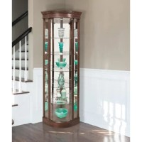 This charming Auberge Lighted Corner Curio Cabinet has tons of character. Beaming with handcrafted pride, this corner curio cabinet features five glass shelves to proudly display and protects your most prized items.