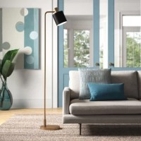 Introduce sleek modern style to your living room or bedroom with this floor lamp. A large round base supports the slightly bent arm, all of which is finished in a neutral, solid metallic hue. The metal drum shade has a black finish and directs the light from a 100W bulb (not included) right on to your sofa or nightstand. To turn this lamp on or off, just use the in-line foot switch. This floor lamp is compatible with an LED bulb.
