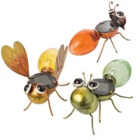 Light up your walkway with this whimsical solar garden insect decoration. This outdoor decoration is made from glass and metal for durability, and the bright colors brighten any environment. This whimsical insect have nice big eyes and a flat back to capture the sun during the day, so it gives off a nice ambient glow at night. This cute insect can be placed in a flower bed, flowerpot, along a walkway or path. It can be placed anywhere in your yard that you want to add a little extra glow to...