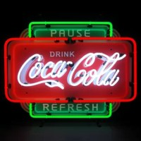 Neonetics Neon Signs feature multi-colored, hand blown neon tubing. The Coca-Cola Pause Refresh neon sign features glowing red, white and green neon tubes. The glass tubes are backed by a beautiful silk screened full-color image, and the entire sign is supported by a black finished metal grid. The sign can be hung against a wall or window; they can even sit on a shelf. All you do is hang it up and plug it in.