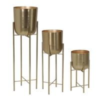 Whether growing flowers or plants, the most stylish way is using this set of three metal crafted planters. Trending gold color, each metal planter has a drum-shaped contour with a rounded bottom featuring slim metal legs adding height and bring greenery into any space. Perfect for a living room, patio, office, or any area in a modern home.