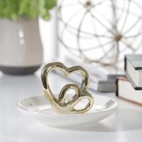 A small and glamorous gift for any special occasion. The perfect modern piece to store the rings you love. White ceramic with metallic gold details trays displaying double gold hearts. Measuring 4.5
