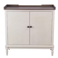 Add style and storage space to your home with this two tone Cabinet. Featuring a sturdy construction of solid wood in the hue of brown and white, it incorporates 2 doors accented with round knobs. Supported on turned legs, it showcases textured details on the door front.