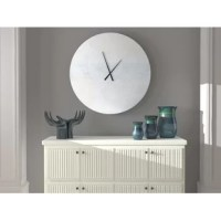 Decorate with style and function that stands apart from traditional wall clocks. This modern design adds a sense of artistic mastery to any wall. Crafted from aluminum metal, this piece features a sleek semi-gloss finish with float mounting to enhance the overall beauty of the clock. Designed to be lightweight making it easy to hang with the mounting hardware, just insert your AA battery.