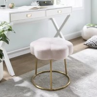 The perfect pairing of minimal lines while still conveying a luxurious style.  Plush velvet is used to create this subtle floral shape that offers soft padding for comfort.  The foundation is an elegant chrome-plated base.  Sitting inches off the floor, this happy stool can fit under a makeup vanity, bathroom prep table, desk, or really, anywhere.  Adds a welcomed pop of color to any room.  Multiple colors to mix and match.