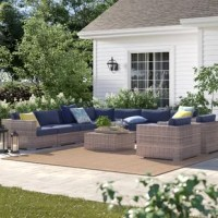 This 10-piece sectional set comes fully assembled with everything you need to make memories – all you need are some loved ones to share it with. It's crafted from rust-proof aluminum wrapped in handwoven wicker for weather resistance. This set includes a large L-shaped sectional sofa, two deep seating club chairs, and a glass-topped coffee table for keeping drinks close at hand. The sofa and chairs are topped with water-resistant cushions stuffed 5'' thick with plush foam, in a sloped design...