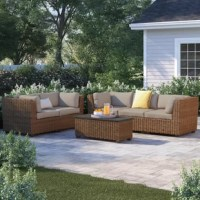 Sunny days with friends are well-spent on the patio. And with an outdoor conversation set like this, who wouldn't want to linger longer? Including a modular sofa, loveseat, and one coffee table, there's plenty of room for up to five people to hang out and rest their drinks. Each piece is founded atop a rust-resistant, powder-coated aluminum frame, which is wrapped in resin wicker, making it weather-, water-, and UV-resistant. Plus, this set is topped off with water-resistant cushions.